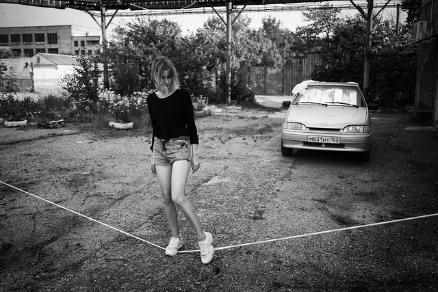 young girl portrait near old car