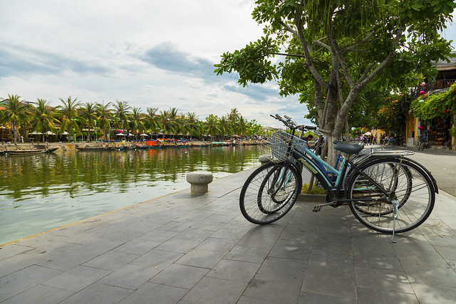 Bicycles parked beside the Thu Bon River in Hoi An Ancient Town (Hoian), Vietnam.