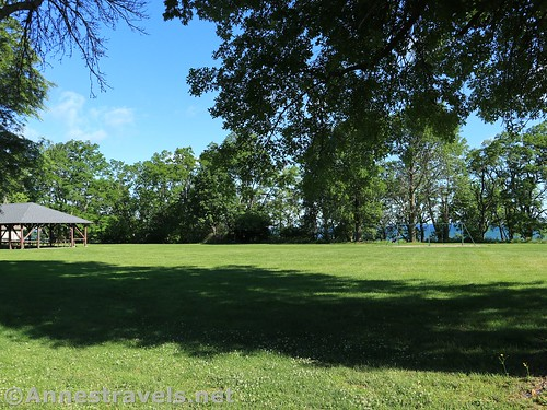 The field with two pavilions and the swingset.  You can see Lake Ontario through the trees.  Webster Park, New York