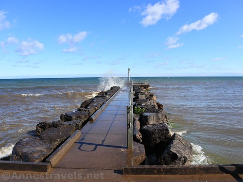Walking out on the fishing pier... avoiding the spray from the waves.  Webster Park, New York
