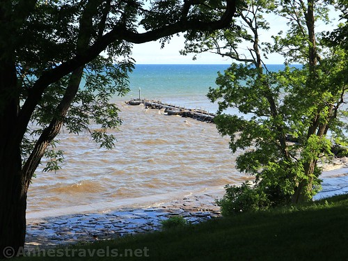 Views down on the fishing pier in Lake Ontario from the hill below the White House Lodge, Webster Park, New York