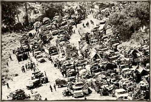 23 Mar 1975, Phu Binh, South Vietnam --- March 23, 1975 - Phu Binh, South Vietnam: The tail end of the convoy of tears remains trapped on the provincial route 7 near Phu Tuc District, 23 miles west of Tuy Hoa, March 23, as the Communist gunners fired into