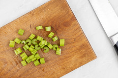 Chopped Celery on the wooden cutting board