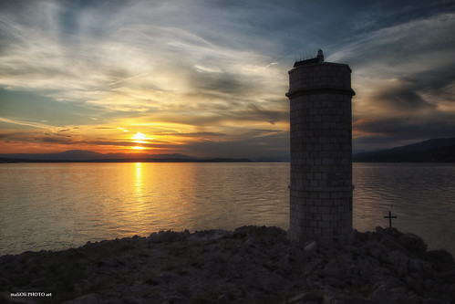 lighthouse sun sunset dusk sundown sky clouds sea seaside shore cliff rocks stone tower golden summer canon adriatic croatia hrvatska europe