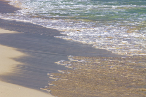 Retreating waves and sunlight on the beach, Valentin Imperial Riviera Maya, Mexico