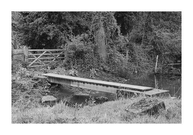 Footbridge from a cow field
