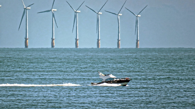 Speedboat and Thanet Wind Farm offshore near Broadstairs, Kent, England