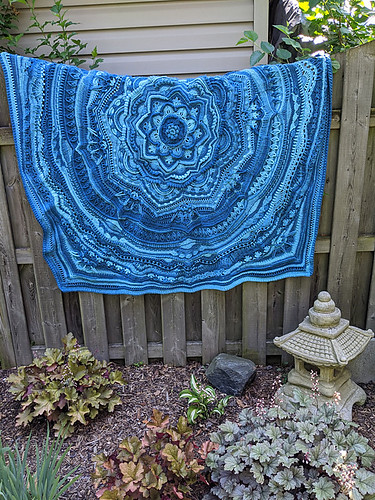 Linda says that she doesn't crochet but this is her second Mandala Madness by Helen Shrimpton! She modified it to make it smaller - it is 64 in he's wide.