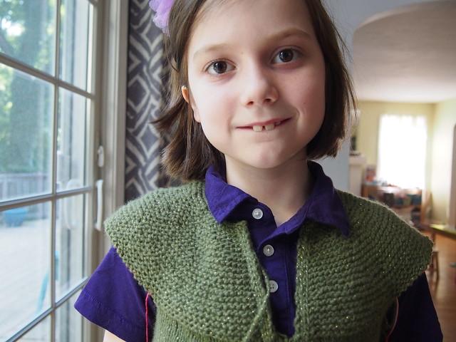 My favorite kid, trying on her vest-in-progress.