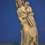 Ivory statue of Virgin and Child with a dragon crushed under her left foot.