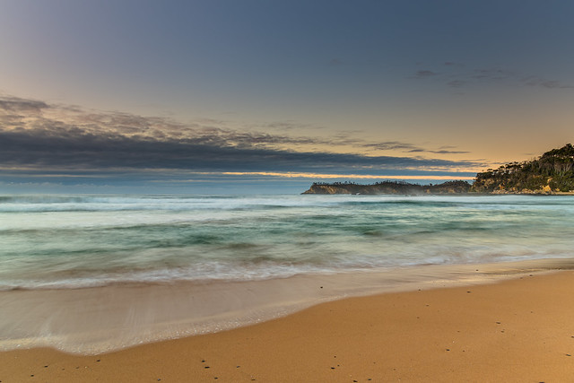 Sunrise seascape and low cloud bank