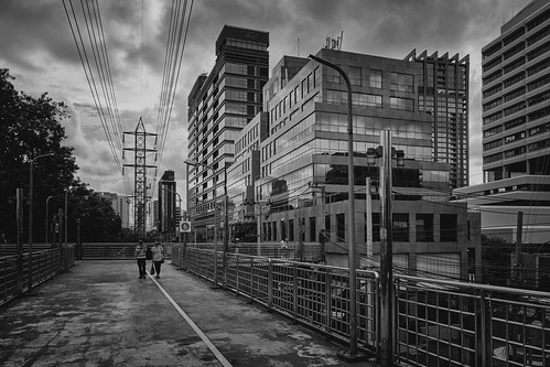 greenmile elevated walkingpath bikepath pathumwandistrict bangkok thailand 2020 blackandwhite bw monochrome landscape cityscape architecture building buildings highrise person persons man woman walking