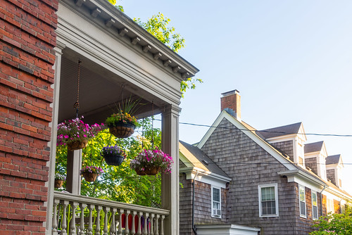 Potted Hanging Flowers on porch on Danforth Street