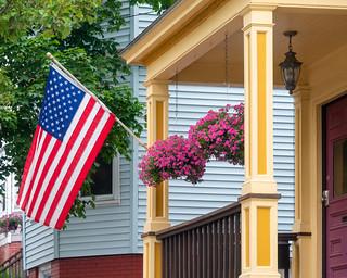 Flag and Flowers on Sheridan Street