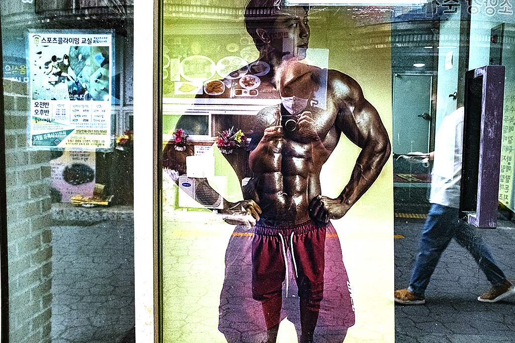 Muscle man on poster in Myeongnyun-dong on 7-6-20--Busan