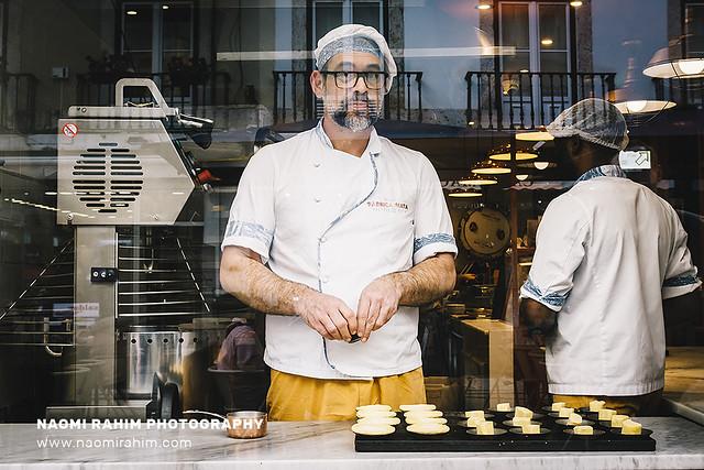 Pastry chef making Pastel de nata, Lisbon