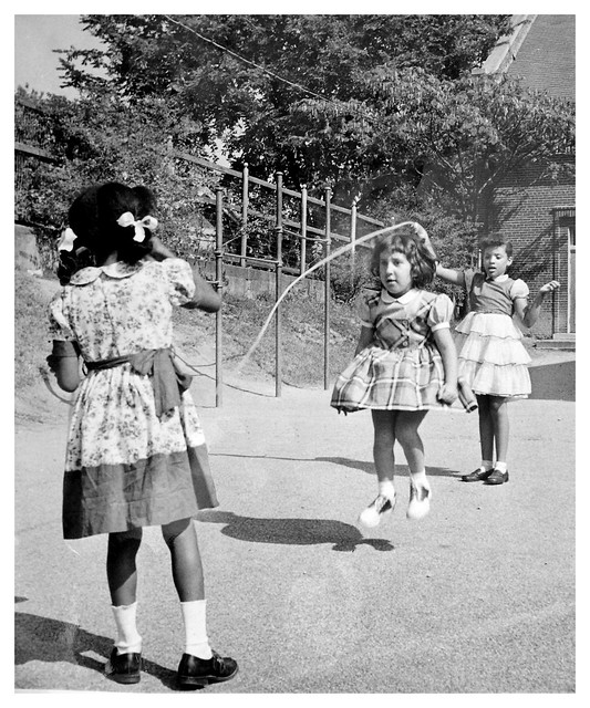 Black & white children play after integration: 1956