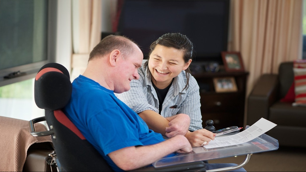 Carer with man with learning disabilities.
