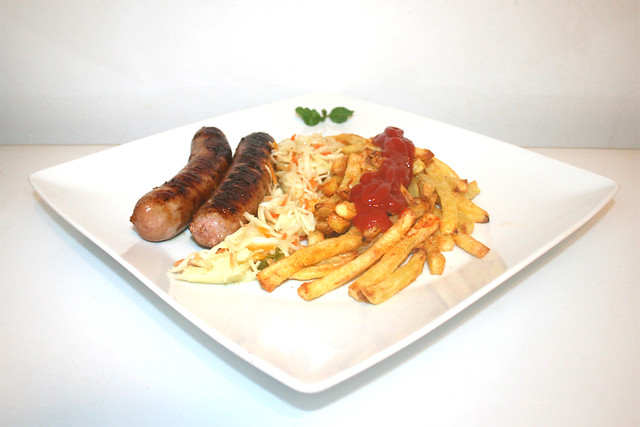 18 - Fried sausage with french fries - Side view / Bratwurst mit Pommes Frites - Seitenansicht