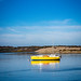 A yellow Boat on Morro Bay