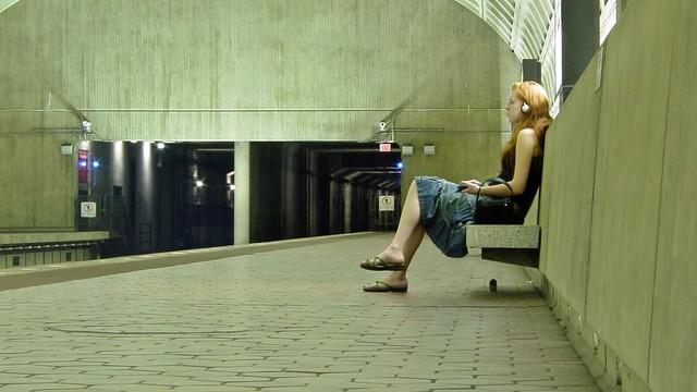 Woman waiting at Ballston-MU station