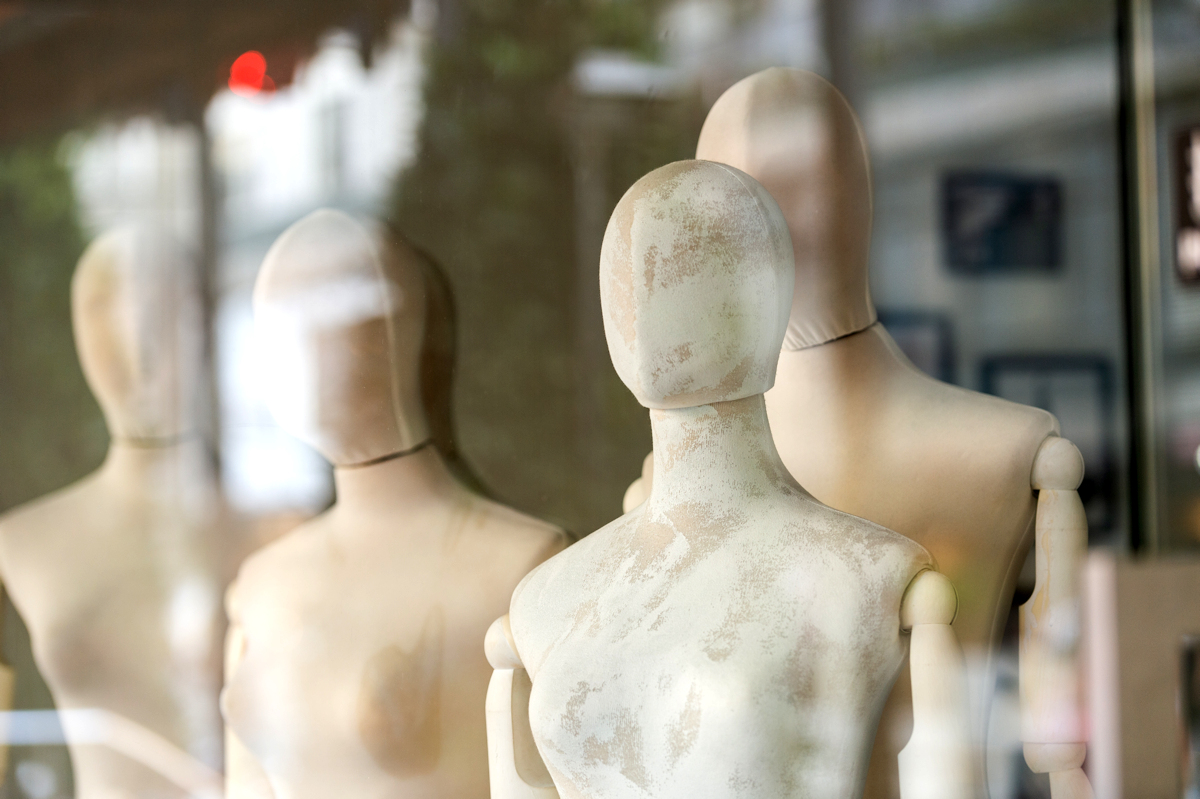 Undressed mannequins in a shop window