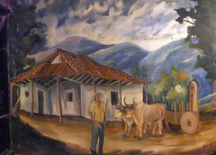 Mural of a small farm with a farmer and oxen with cart in Ostional, Costa Rica