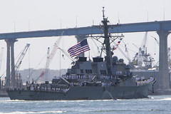 Sailors man the rails as USS Russell (DDG 59) transits San Diego Bay, July 8. (U.S. Navy/MC1 Woody S. Paschall)