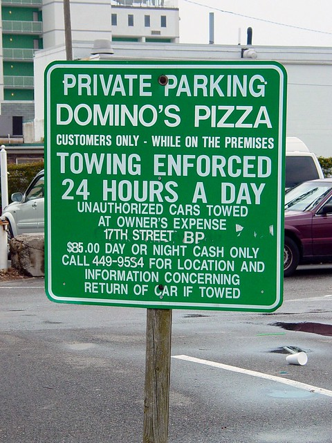 Parking sign at Domino's Pizza