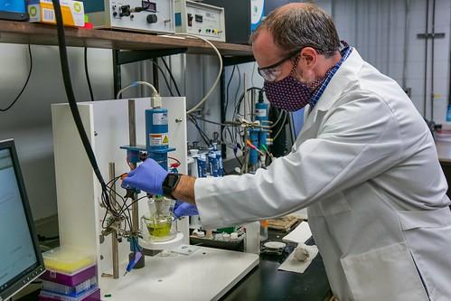 Byron Farnum works in his lab.