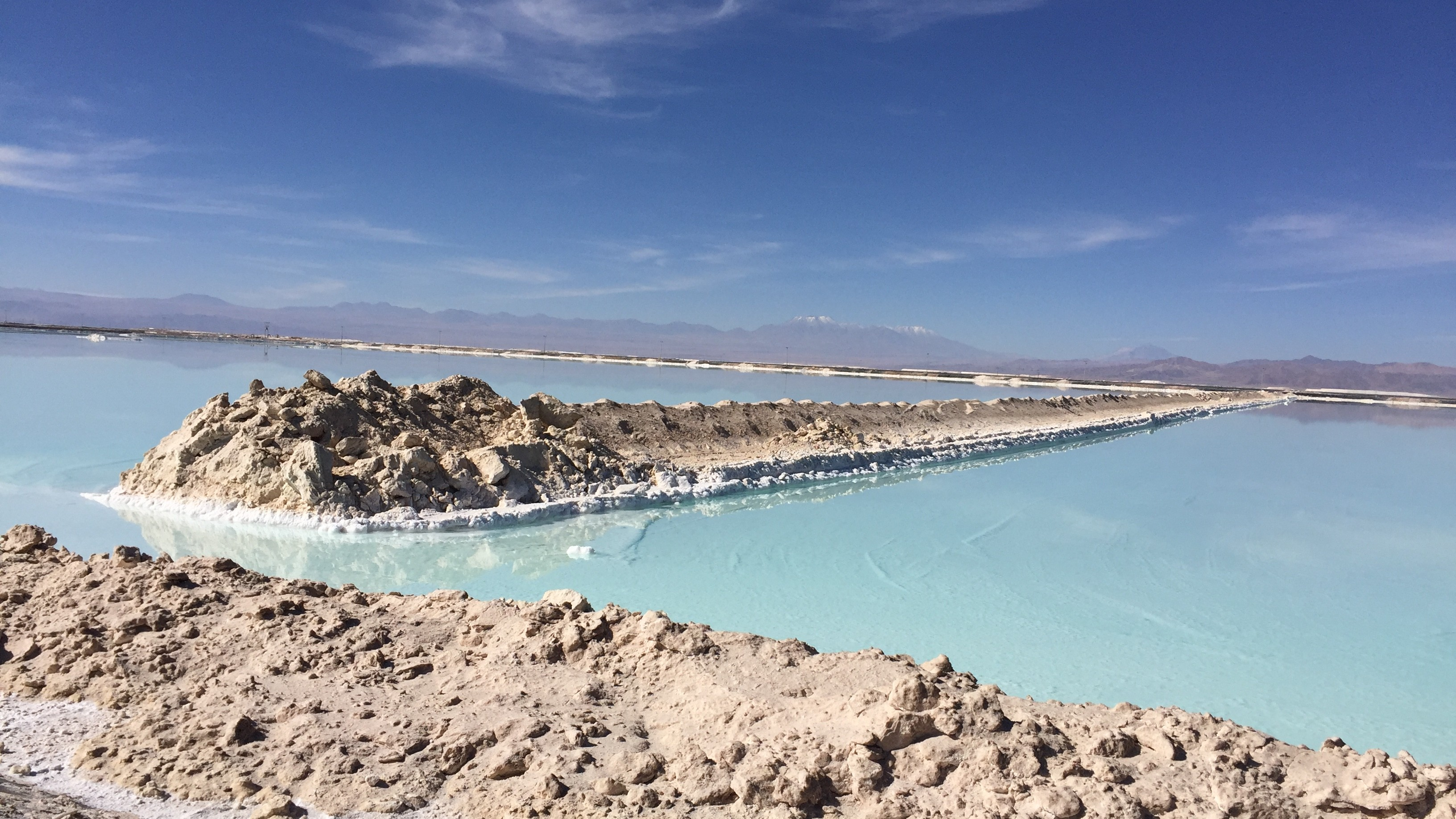 a very blue lake, where lithium is mined