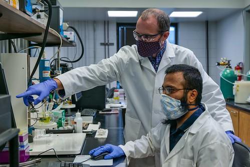 Byron Farnum and Motiur Mazumder in the lab.