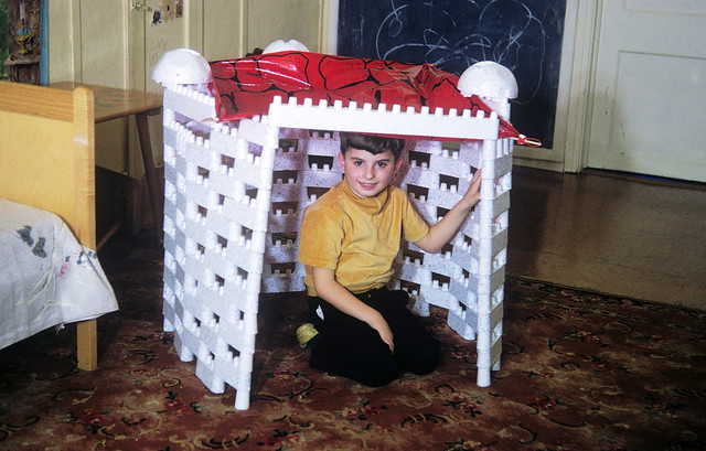 OK, fellow Baby Boomers... who remembers the Flintstones styrofoam building block kit which was sold in the early to mid 1960s. That's me in a recently completed Igloo up in my room. Yabadabadoooo! Milford Connecticut. March 1966.