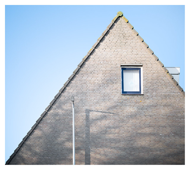 Dutch house with lamppost on a sunny day