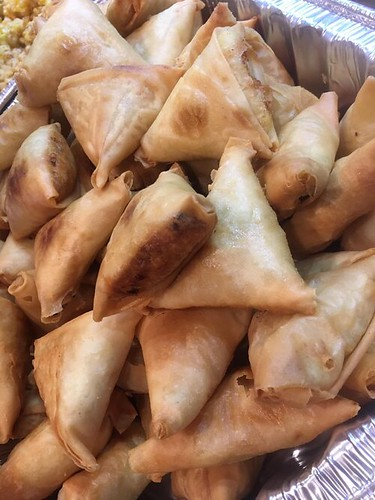 Samosas made by refugee chefs with Tables Across Borders