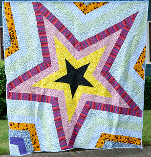 The second of the two Star Storm quilts made from hospital gowns and other memories.