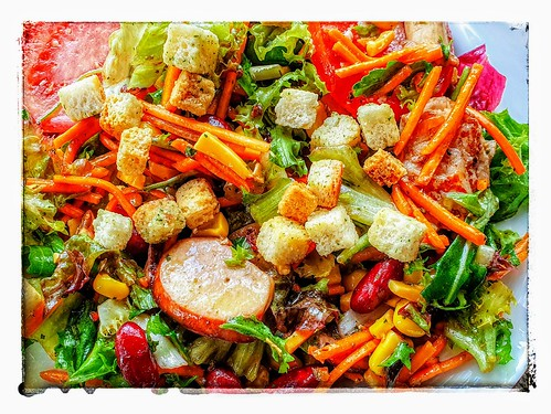 Mixed salad with carrots, kidney beans, corn, tomatoes, chicken, croutons