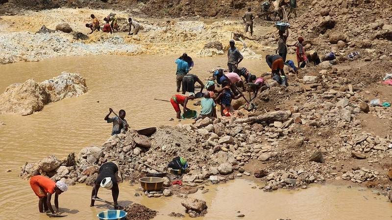 a group of people mining for gold