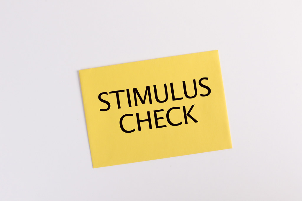 Yellow envelope with Stimulus check text on white backgrou… - Flickr