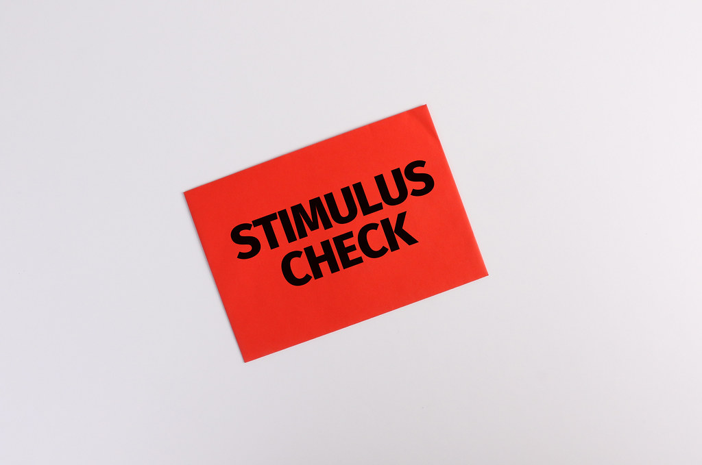 Red envelope with Stimulus Check text on white background - Flickr