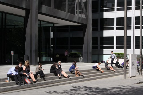 Officer workers get some lunchtime sun outside 140 William Street