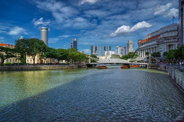 Singapore river with Fullerton hotel and Cavenagh bridge