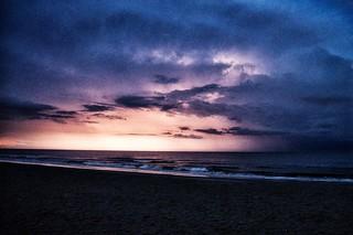 morning sunrise storm at sea