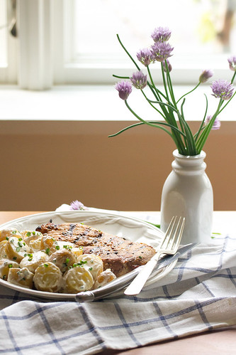 Yogurt-Chive Potato Salad on a Plate with a Pork Chop | by Isabelle @ Crumb