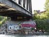 hanging out under a rail bridge