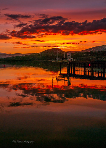 landscapelovers landscape sunset colourfulsky redsky clouds water okanagan okanaganlake okanaganvalley kelowna britishcolumbia canada pier wharf reflections tranquility serenity artistic
