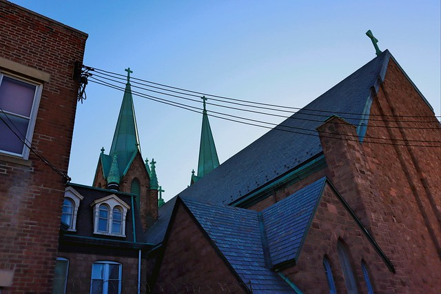 The rear of Saint Laurentius Church in Philadelphia. The steeples catch the morning sun.