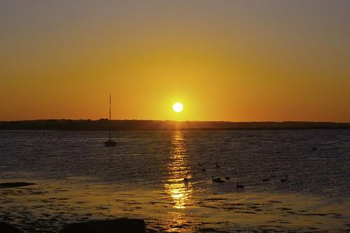 sunrise morning dawn beach shore coast ocean sea water landscape nature sun sky summer vacation