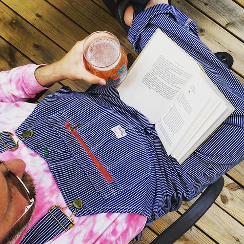 Book, beer, and bibs? #reading #yum #beer #overalls #dungarees #biboveralls #lckingmfg #hickorystripe #denimoveralls #overallsarelife