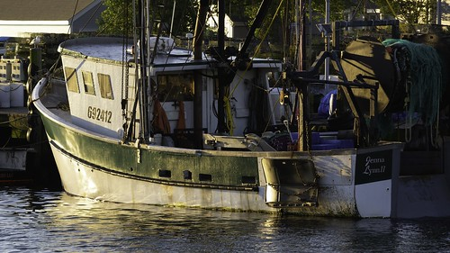 commercial fisherman trawler boat ship vessel nautical maritime ocean sea coast shore sunrise morning calm